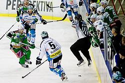 Ales Music (HDD Tilia Olimpija, #16) and Franklin MacDonald (EHC Liwest Linz, #5) during ice-hockey match between HDD Tilia Olimpija and EHC Liwest Black Wings Linz at second match in Semifinal  of EBEL league, on March 8, 2012 at Hala Tivoli, Ljubljana, Slovenia. (Photo By Matic Klansek Velej / Sportida)
