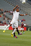 July 24th, 2012:  Swansea City AFC midfielder Kemy Agustien (26) out jumps Colorado Rapids forward Kamani Hill (13) in the Rapids 2-1 win over Swansea City AFC in a international friendly soccer match in Denver, CO.