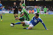 AFC Wimbledon striker Andy Barcham (17) and Peterborough United defender Michael Smith (2) tussle during the EFL League 1 match between Peterborough United and AFC Wimbledon at ABAX Stadium, London Road, Peterborough, England on 22 October 2016. Photo by Stuart Butcher.