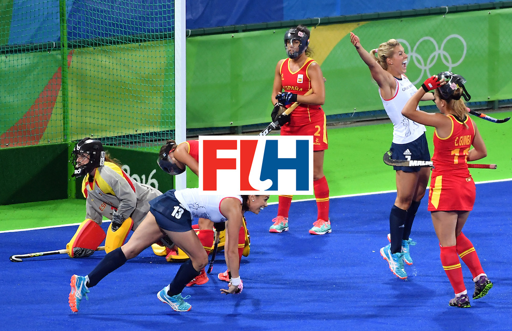 Britain's Georgie Twigg (2nd R) celebrates a goal during the women's quarterfinal field hockey Britain vs Spain match of the Rio 2016 Olympics Games at the Olympic Hockey Centre in Rio de Janeiro on August 15, 2016. / AFP / Pascal GUYOT        (Photo credit should read PASCAL GUYOT/AFP/Getty Images)