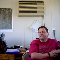 Gallup Land Partners project manager Jake Bracken sits in an office in a portable trailer where he oversees the Gallup Flea Market Saturday.