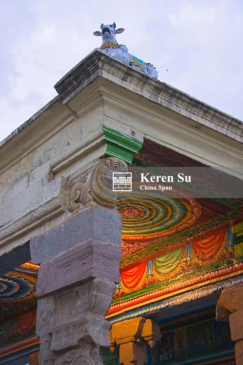 Statue of Nandi the bull, vehicle for Shiva on roof top, Sree Meenakshi Temple complex, Madurai, Tamil Nadu State, India