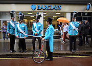 © Licensed to London News Pictures. 07/07/2012. London, UK Barclays staff prepare to join the march. Guests at the World Pride Procession in Central London today 7th July 2012. Despite reports of it's cancellation due to financial difficulty the scaled-down event went ahead after changes to its schedule. Photo credit : Stephen Simpson/LNP