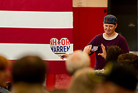 Elizabeth Warren supporters take a photo op at Laconia Middle School on Tuesday.  (Karen Bobotas/for the Laconia Daily Sun)