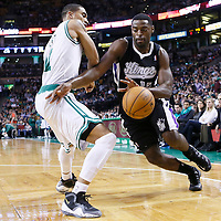 30 January 2013: Sacramento Kings point guard Tyreke Evans (13) drives past Boston Celtics shooting guard Courtney Lee (11) during the Boston Celtics 99-81 victory over the Sacramento Kings at the TD Garden, Boston, Massachusetts, USA.