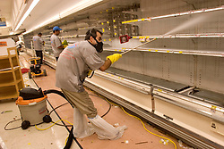 30th Sept, 2005.  New Orleans, Louisiana. Hurricane Katrina aftermath. <br /> Disaster recovery private contractors pressure wash and bleach clean the Winn Dixie supermarket in Uptown New Orleans as businesses and locals return to the city. The supermarket hopes to open on October 6th.<br /> Photo; ©Charlie Varley/varleypix.com