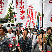 TOKYO, JAPAN - MAY 1 : Thousands of labor union members gather around with their union banners as they attend the May Day rally in Yoyogi Park on May 1, 2017, Tokyo, Japan. (Photo by Richard Atrero de Guzman/NUR Photo)