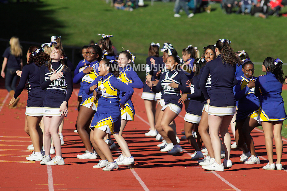 Beacon, New York -  Beacon cheerleaders perform during a high school football game on Saturday, Oct. 10, 2009.