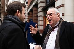 Opera administrator Robert, 70, right, talks with Bild journalist Philip Fabian about Brexit in St James, London. London, January 16 2019.
