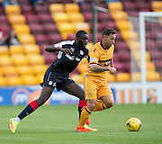 Motherwell's Scott McDonald and Dundee's Kevin Gomis - Motherwell v Dundee in the Ladbrokes Scottish Premiership at Fir Park, Motherwell. Photo: David Young<br />