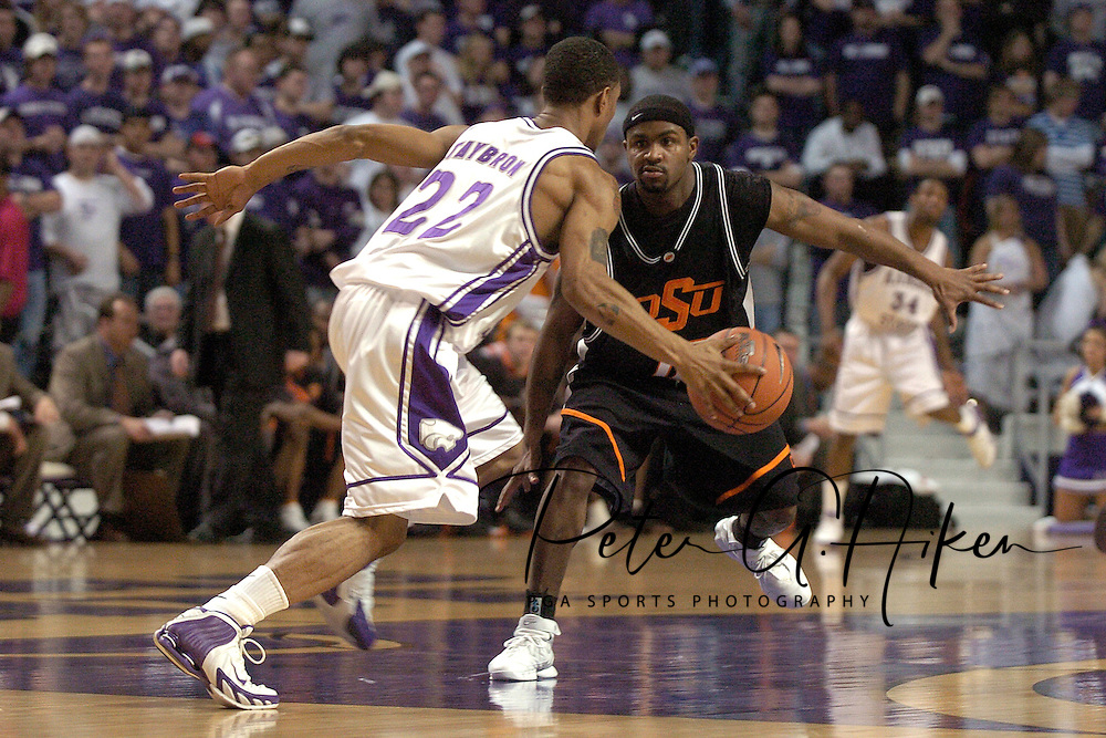 Kansas State guard Mario Taybron (22) drives up court against pressure from Oklahoma State guard Jamaal Brown (10) at Bramlage Coliseum in Manhattan, Kansas, February 4, 2006.  The Cowboys  defeated K-State 63-61.