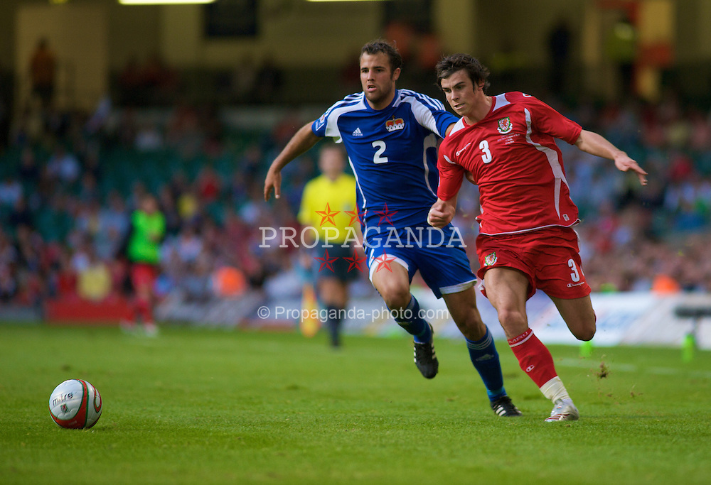 CARDIFF, WALES - Saturday, October 11, 2008: Wales' Gareth Bale and Liechtenstein's Marco Ritzberger during the 2010 FIFA World Cup South Africa Qualifying Group 4 match at the Millennium Stadium. (Photo by Gareth Davies/Propaganda)