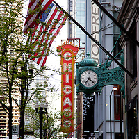 Chicago Theatre sign and Macy's (Marshall Field's) clock. The Chicago Theater is a Chicago Landmark and is listed with the National Register of Historic Places.