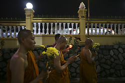 May 9, 2017 - Kuala Lumpur, Malaysia - Devotees hold candles, incense and lotus flowers as they perform religious rites during the early hours of Vesak Day at Chetawan Temple, Kuala Lumpur on 10 May 2017. Vesak Day commemorates the birth, enlightenment of Buddha, and is celebrated by Buddhists in Asia. (Credit Image: © Mat Zain/NurPhoto via ZUMA Press)