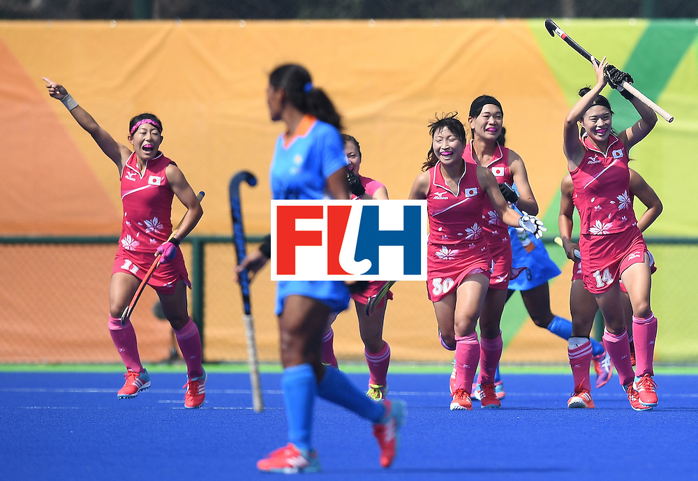 Japan's Emi Nishikori (R) celebrates scoring a goal with teammates during the women's field hockey Japan vs India match of the Rio 2016 Olympics Games at the Olympic Hockey Centre in Rio de Janeiro on August, 7 2016. / AFP / MANAN VATSYAYANA        (Photo credit should read MANAN VATSYAYANA/AFP/Getty Images)