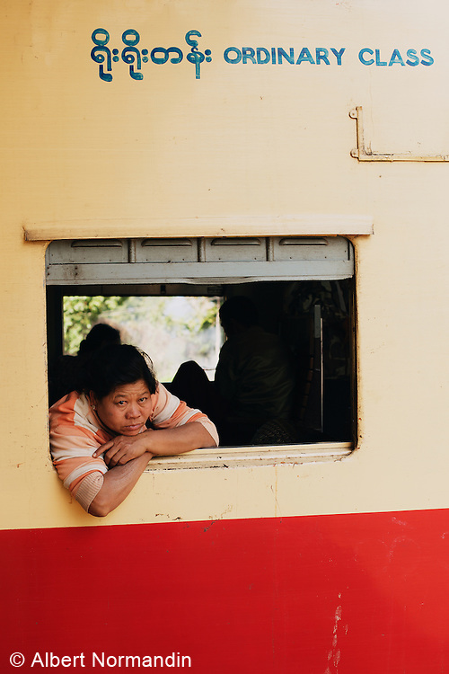 Woman in train window at Nawnghkio Town Station, Ordinary Class
