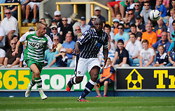 Millwall's Danny Shittu comes under pressure by Yeovil Town's Paddy Madden - Photo mandatory by-line: Seb Daly/JMP - Tel: Mobile: 07966 386802 03/08/2013 - SPORT - FOOTBALL - The Den - Millwall -  Millwall V Yeovil Town - Sky Bet Championship