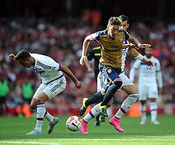 Mesut Ozil of Arsenal battles for the ball - Mandatory by-line: Joe Meredith/JMP - 25/07/2015 - SPORT - FOOTBALL - London,England - Emirates Stadium - Arsenal v Lyon - Emirates Cup