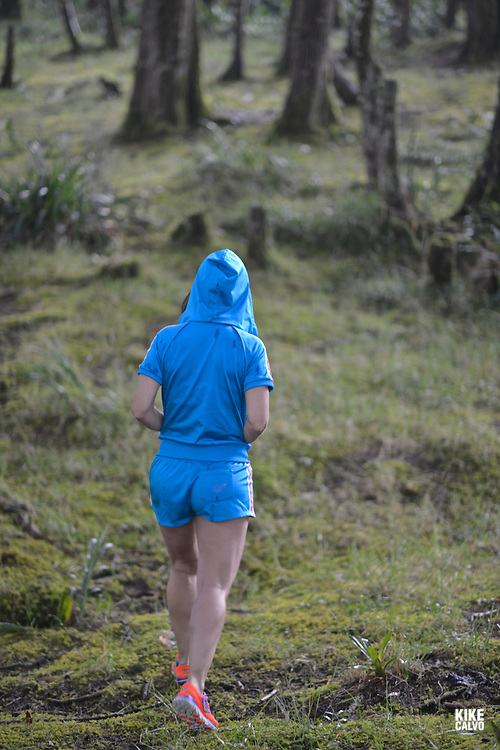 Hispanic woman in her forties exercising fitness workout in a forest.  May 29, 2014. (Kike Calvo via AP Images)
