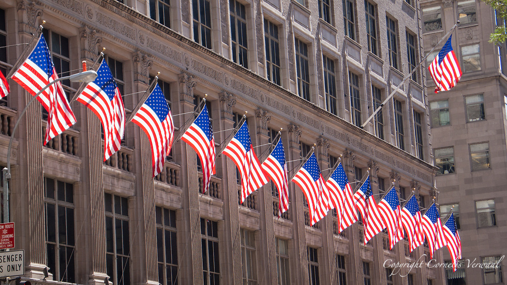 Flags on the flagship store of Saks Fifth Avenue