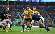 Australia's Bernard Foley attacking the Soctland try line during the Rugby World Cup Quarter Final match between Australia and Scotland at Twickenham, Richmond, United Kingdom on 18 October 2015. Photo by Matthew Redman.