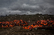In this photo taken through a car window, piles of life jackets used by refugees and migrants to cross the Aegean sea from the Turkish coast remain stacked on the northeastern Greek island of Lesbos, on Wednesday, on Thursday, Jan. 7, 2016. The European Union says Turkey is not doing enough to halt the flow of migrants as countries in northern Europe tighten border controls in an effort to manage the arrivals. (AP Photo/Santi Palacios)