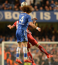 30.04.2014, Stamford Bridge, London, ENG, UEFA CL, FC Chelsea vs Atletico Madrid, Halbfinale, Rueckspiel, im Bild Chelsea's defender David Luiz and Athletico Madrid's midfielder Arda Turan compete for the ball // Chelsea's defender David Luiz and Athletico Madrid's midfielder Arda Turan compete for the ball during the UEFA Champions League Round of 4, 2nd Leg Match between Chelsea FC and Club Atletico de Madrid at the Stamford Bridge in London, Great Britain on 2014/05/01. EXPA Pictures &copy; 2014, PhotoCredit: EXPA/ Mitchell Gunn<br /> <br /> *****ATTENTION - OUT of GBR*****