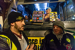 """A pro-Remain campaigner aboard the """"Bollocks to Brexit"""" Bus looks on as Pro-Brexit campaigner James Goddard in his 'gilet juane' attempts to stop its arrival at at Steve Bray's  ongoing SODEM pro-remain protest at Old Palace Yard outside Parliament. Westminster, London, December 20 2018."""
