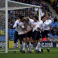 Photo. Glyn Thomas.<br /> Manchester City v Tottenham Hotspur. FA Cup fourth round. <br /> City of Manchester Stadium, Manchester. 25/01/2004.<br /> Spurs' Gary Doherty (C) is mobbed by teammates after scoring his side's equaliser.