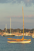 USA, Newport, RI - A classic yacht sits on it's mooring in Newport Harbor.