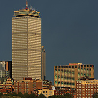 Boston architecture photography of the Back Bay skyline showing historic and modern architectural landmarks such as The Pru and the Boston Sheraton Hotel on a stormy sunset eveneing.<br />