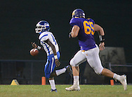 Conwell-Egan Catholic's Kendall Jones #4 fumbles the football as he is chased by Upper Moreland's Connor Dolan #65 in the first quarter at Upper Moreland High School Friday September 18, 2015 in Willow Grove, Pennsylvania.  (Photo by William Thomas Cain)
