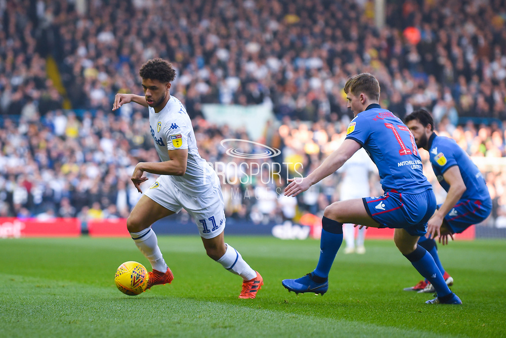 Tyler Roberts of Leeds United (11) gets past Callum Connolly of Bolton Wanderers (17) during the EFL Sky Bet Championship match between Leeds United and Bolton Wanderers at Elland Road, Leeds, England on 23 February 2019.