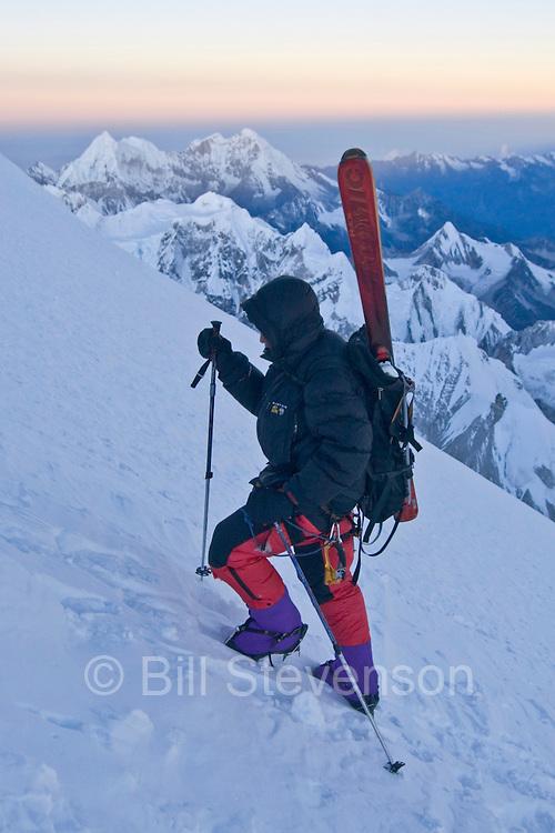 A Man Climbing With Skis on a Mountain the Himalaya