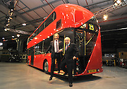 ©London News pictures...11/11/2010. Boris Johnson (R) and The Secretary of State for Northern Ireland, Owen Paterson MP, where the bus is being made, hop off the rear platform. Boris Johnson, London's Mayor, unveils a life size mock up of a new bus for London, today (11/11/10). The mock up gives Londoners the first glimpse of how the bus will look when it is put into service in 2012