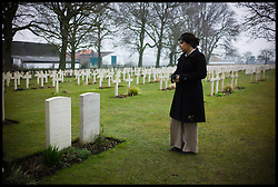 Baroness Sayeeda Warsi looking at the graves of a Chinese and Hindu Soldiers at the Lijssenthoek Military Cemetery in Belgium. Sayeeda is visiting the graves of Commonwealth soldiers on the battlefields of France and Belgium as part of the UK Government's programme to commemorate the centenary of the First World War which starts next year, Wednesday  April 10, 2013. Photo By Andrew Parsons / i-Images