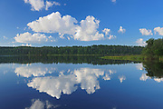 Clouds reflected in the English River , Ear Falls, Ontario, Canada
