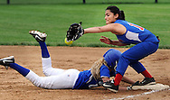 GLENSIDE, PA - MAY 29:  Cnwell-Egan's Alyssa Adams dives safely back to first as Swenson's first baseman Yasmilex Palmer loses the ball during the District 12 Class AA softball championship May 29, 2014 at Arcadia University in Glenside, Pennsylvania. Conwell-Egan defeated Swenson 15-0. (Photo by William Thomas Cain/Cain Images)