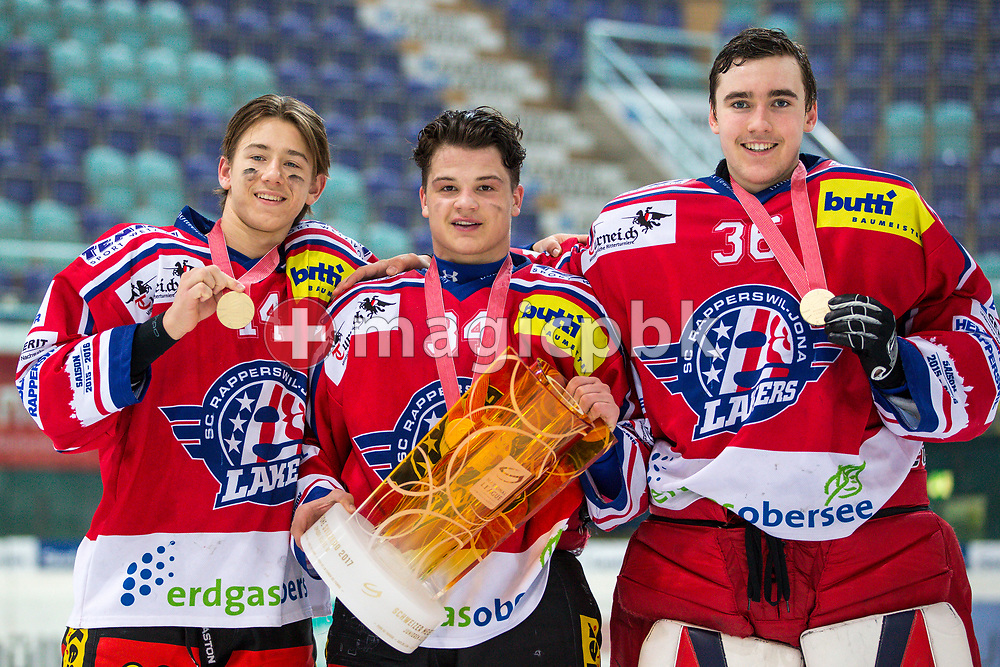 (L-R) Rapperswil-Jona Lakers players Julian Banjavcic, Janis Egger and Beat Trudel pose for a photo with their gold medals and the Swiss Champion trophy after winning the fifth Elite B Playoff Final ice hockey game between Rapperswil-Jona Lakers and ZSC Lions held at the SGKB Arena in Rapperswil, Switzerland, Sunday, Mar. 19, 2017. (Photo by Patrick B. Kraemer / MAGICPBK)