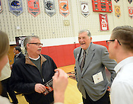Ralph Wetzel (wrestling) (2nd from right) speaks with a group of former students during a Salute to Hatboro-Horsham Coaching Legends Friday January 15, 2016 at Hatboro-Horsham High School in Hosham, Pennsylvania. (Photo by William Thomas Cain)