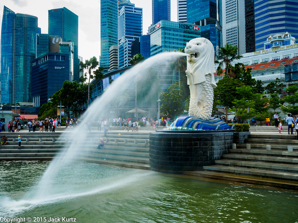 """26 DECEMBER 2015 - SINGAPORE, SINGAPORE:  The """"Merlion"""" is a landmark in Singapore. It's a combination of a mermaid and a lion. In Singapore, it has become a marketing icon used as a mascot and national personification of Singapore. Merlions do not feature in any local folklore or myths of Singapore, and was only used in Singapore initially as the logo for the tourism board. PHOTO BY JACK KURTZ"""