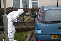 © Licensed to London News Pictures. 05/01/2019. Farnham, UK. Police forensics officers search a car v parked outside a property after a couple were arrested in connection with the murder of a man on a train yesterday. A murder investigation has been launched after the man was attacked while on board the 12. 58pm train service travelling between Guildford and London Waterloo. A man and a woman have been detained by police in Farnham in connection with the murder. Photo credit: Peter Macdiarmid/LNP