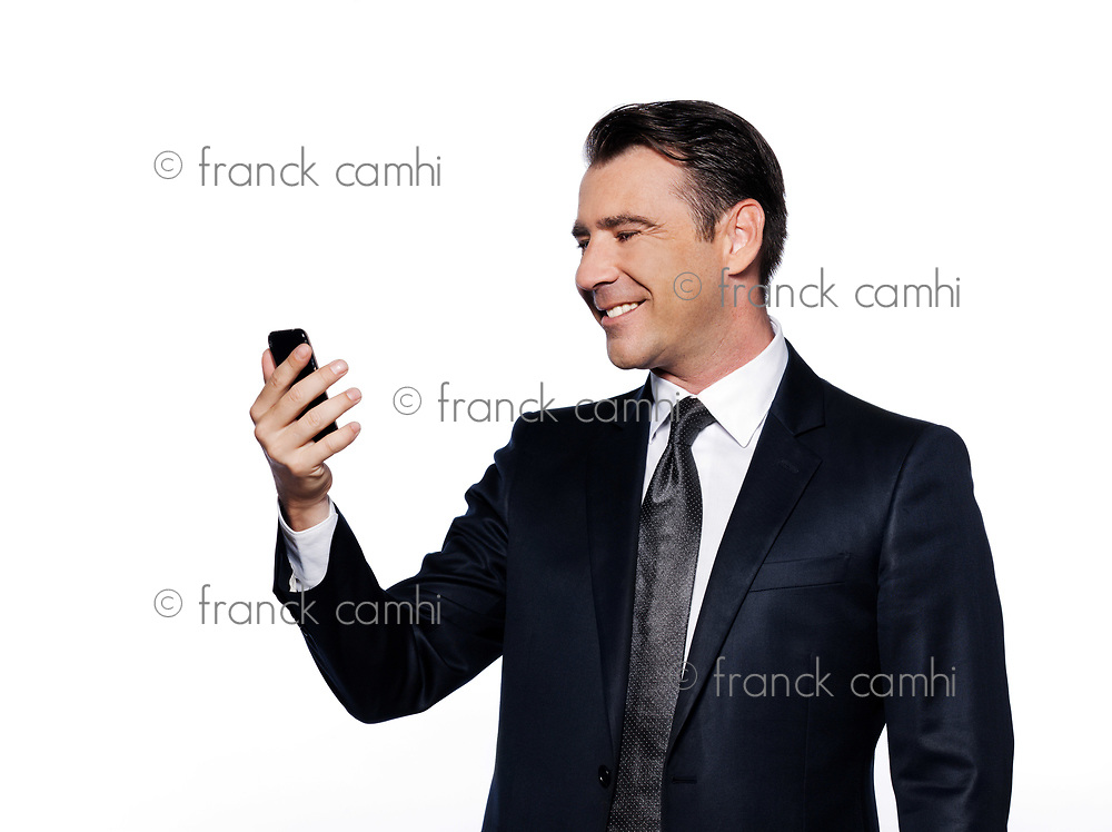 caucasian handsome man holding cell phone happy portrait isolated studio on white background