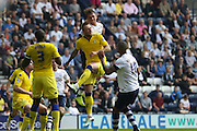 Joe Garner wins a header during the Sky Bet Championship match between Preston North End and Leeds United at Deepdale, Preston, England on 7 May 2016. Photo by Pete Burns.