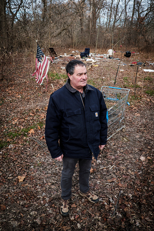 ELKTON, MARYLAND - DECEMBER 26: Zane Cambell wanders through a homeless encampment in the woods near his home in Elkton, Maryland on Tuesday, December 26, 2017 in Elkton, Maryland. Campbell likes to talk about how he feels his life is in shambles after a long history of alcoholism. Campbell was born into one of the most revered clans of old-time country music. His aunt was the legendary singer-songwriter Ola Belle Reed, and his uncle was Alex Campbell, a bluegrass singer who hosted shows at the country music parks along the Pennsylvania/Maryland border. (Photo by Pete Marovich For The Washington Post)