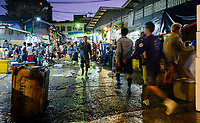 YANGON, MYANMAR - People walking at Yangon fish market at dawn.