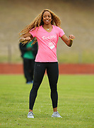 Mar 10, 2018; Cape town, South Africa; Natasha Hastings, 2 time Olympic medal winner, shows the athletes how to warm up during the TrackGirlz events at University of Western Cape on March 10, 2018 in Cape Town, South Africa. (Roger Sedres/Image of Sport)