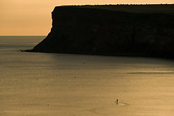 © Licensed to London News Pictures. <br /> 28/08/2017<br /> SALTBURN-BY-THE-SEA, UK.  <br /> A paddle boarder goes for a morning paddle as sunrise in Saltburn-by-the-Sea on Bank Holiday Monday.<br />   <br /> Photo credit: Ian Forsyth/LNP