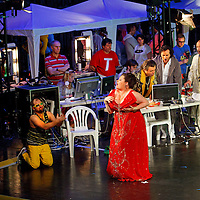 Picture shows : Karen Cargill as Isabella (centre)..Picture  ©  Drew Farrell Tel : 07721 -735041..A new Scottish Opera production of  Rossini's 'The Italian Girl in Algiers' opens at The Theatre Royal Glasgow on Wednesday 21st October 2009..(Soap) opera as you've never seen it before..Tonight on Algiers.....Colin McColl's cheeky take on Rossini's comic opera is a riot of bunny girls, beach balls, and small screen heroes with big screen egos. Set in a TV studio during the filming of popular Latino soap, Algiers, the show pits Rossini's typically playful and lyrical music against the shoreline shenanigans of cast and crew. You'd think the scandal would be confined to the outrageous storylines, but there's as much action off set as there is on.... .Italian bass Tiziano Bracci makes his UK debut in the role of Mustafa. Scottish mezzo-soprano Karen Cargill, who the Guardian called a 'bright star' for her performance as Rosina in Scottish Opera's 2007 production of The Barber of Seville, sings Isabella. .Cast .Mustafa...Tiziano Bracci.Isabella..Karen Cargill.Lindoro...Thomas Walker.Elvira...Mary O'Sullivan.Zulma...Julia Riley.Haly...Paul Carey Jones.Taddeo...Adrian Powter. .Conductors.Wyn Davies.Derek Clarke (Nov 14). .Director by Colin McColl.Set and Lighting Designer by Tony Rabbit.Costume Designer by Nic Smillie..New co-production with New Zealand Opera.Production supported by.The Scottish Opera Syndicate.Sung in Italian with English supertitles..Performances.Theatre Royal, Glasgow - October 21, 25,29,31..Eden Court, Inverness - November 7. .His Majesty's Theatre, Aberdeen  - November 14..Festival Theatre,Edinburgh - November 21, 25, 27 ...Note to Editors:  This image is free to be used editorially in the promotion of Scottish Opera. Without prejudice ALL other licences without prior consent will be deemed a breach of copyright under the 1988. Copyright Design and Patents Act  and will be subject to payment or legal action, where appropriate..Further further informatio