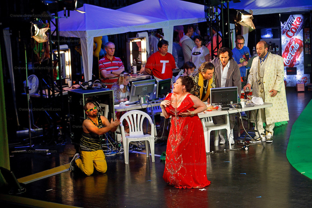 Picture shows : Karen Cargill as Isabella (centre)..Picture  ©  Drew Farrell Tel : 07721 -735041..A new Scottish Opera production of  Rossini's 'The Italian Girl in Algiers' opens at The Theatre Royal Glasgow on Wednesday 21st October 2009..(Soap) opera as you've never seen it before..Tonight on Algiers.....Colin McColl's cheeky take on Rossini's comic opera is a riot of bunny girls, beach balls, and small screen heroes with big screen egos. Set in a TV studio during the filming of popular Latino soap, Algiers, the show pits Rossini's typically playful and lyrical music against the shoreline shenanigans of cast and crew. You'd think the scandal would be confined to the outrageous storylines, but there's as much action off set as there is on.....Italian bass Tiziano Bracci makes his UK debut in the role of Mustafa. Scottish mezzo-soprano Karen Cargill, who the Guardian called a 'bright star' for her performance as Rosina in Scottish Opera's 2007 production of The Barber of Seville, sings Isabella..Cast .Mustafa...Tiziano Bracci.Isabella..Karen Cargill.Lindoro...Thomas Walker.Elvira...Mary O'Sullivan.Zulma...Julia Riley.Haly...Paul Carey Jones.Taddeo...Adrian Powter..Conductors.Wyn Davies.Derek Clarke (Nov 14)..Director by Colin McColl.Set and Lighting Designer by Tony Rabbit.Costume Designer by Nic Smillie..New co-production with New Zealand Opera.Production supported by.The Scottish Opera Syndicate.Sung in Italian with English supertitles..Performances.Theatre Royal, Glasgow - October 21, 25,29,31..Eden Court, Inverness - November 7. .His Majesty's Theatre, Aberdeen  - November 14..Festival Theatre,Edinburgh - November 21, 25, 27 ...Note to Editors:  This image is free to be used editorially in the promotion of Scottish Opera. Without prejudice ALL other licences without prior consent will be deemed a breach of copyright under the 1988. Copyright Design and Patents Act  and will be subject to payment or legal action, where appropriate..Further further informatio